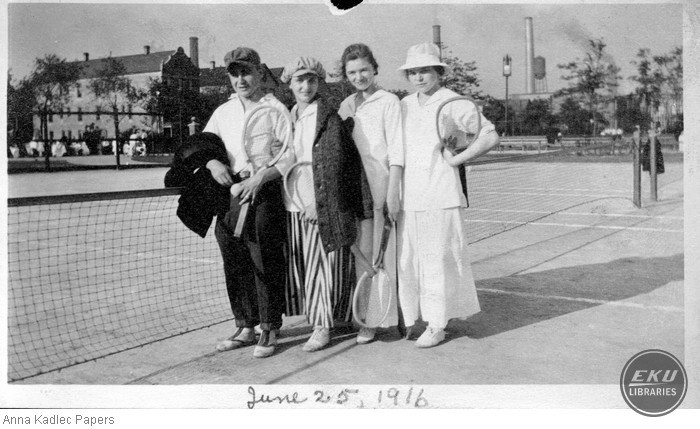 Anna Kadlec (right) and three Unidentified People on the Tennis Courts
