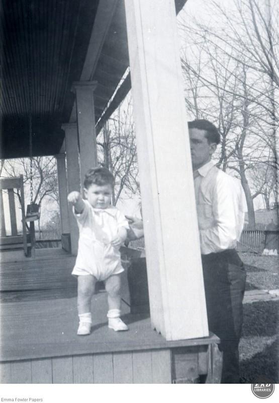 Unidentified Man next to a Child