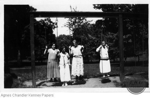 Female students on playground swings in the Ravine
