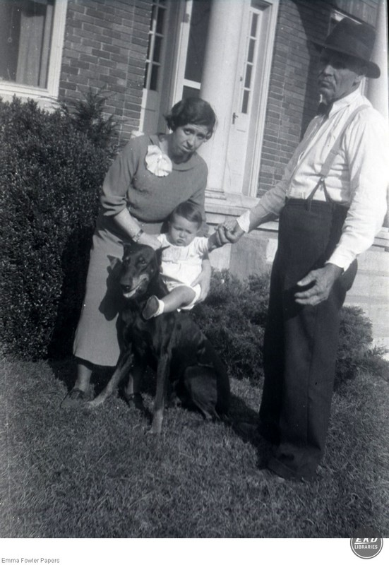 Unidentified Man and Woman holding a Baby