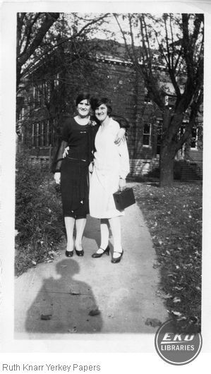 Sara Marsh and Ora Kelly in front of the University Building