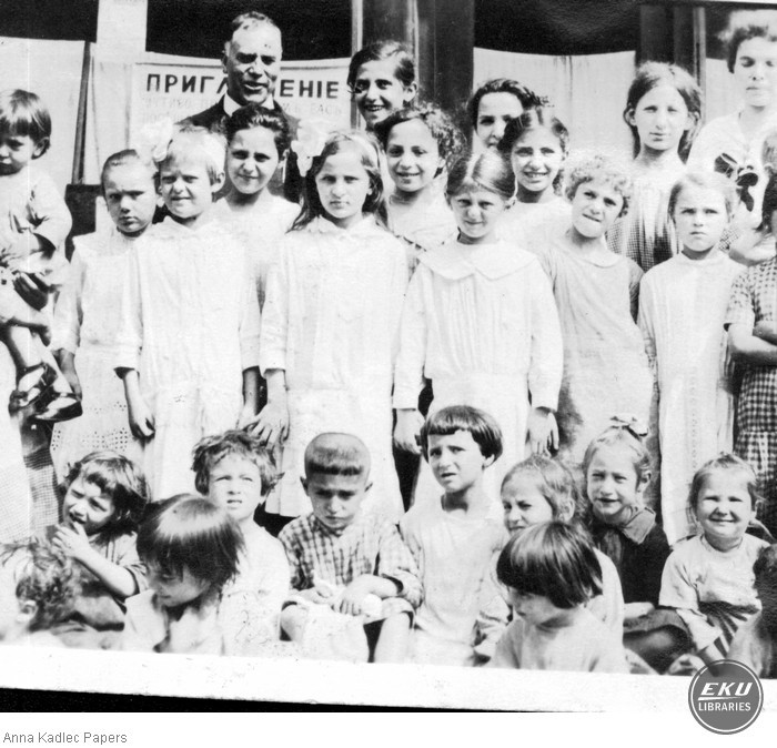 Anna Kadlec (top right) with an Unidentified Group of Children.