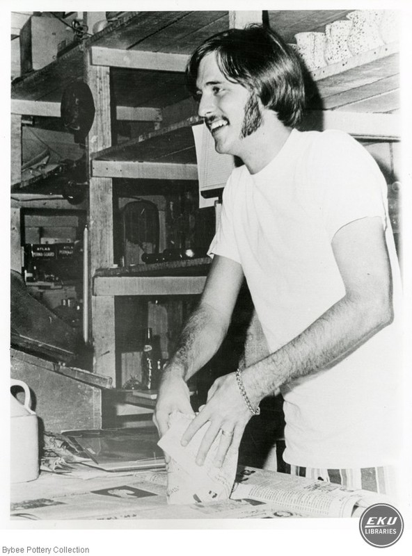 Unidentified Man Wrapping Pottery