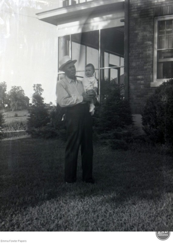 Unidentified Man Holding a Child