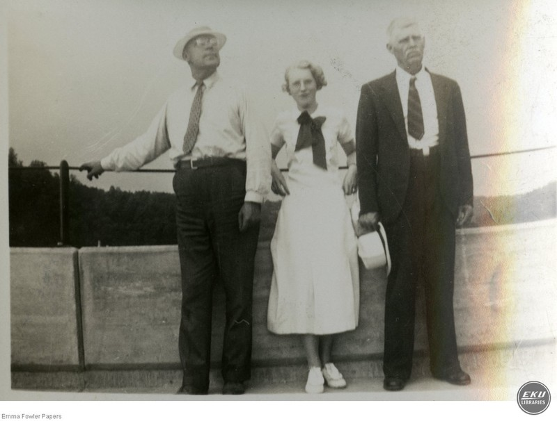 Two Unidentified Men and a Woman
