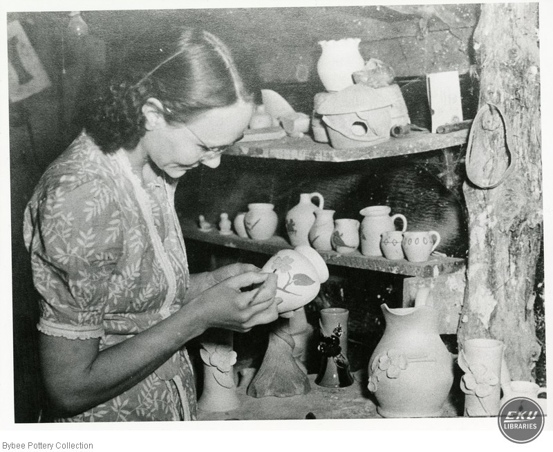 Unidentified Woman Painting Pots