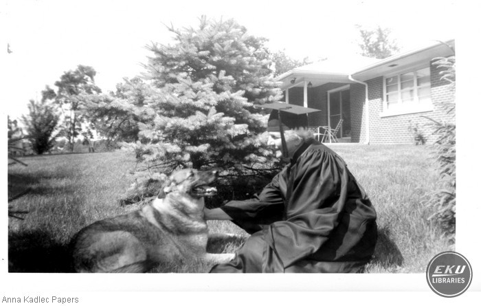 Anna Kadlec in Cap and Gown with her dog Victoria