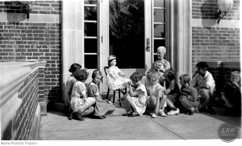 Marie L. Roberts at the West Library Entrance with Children
