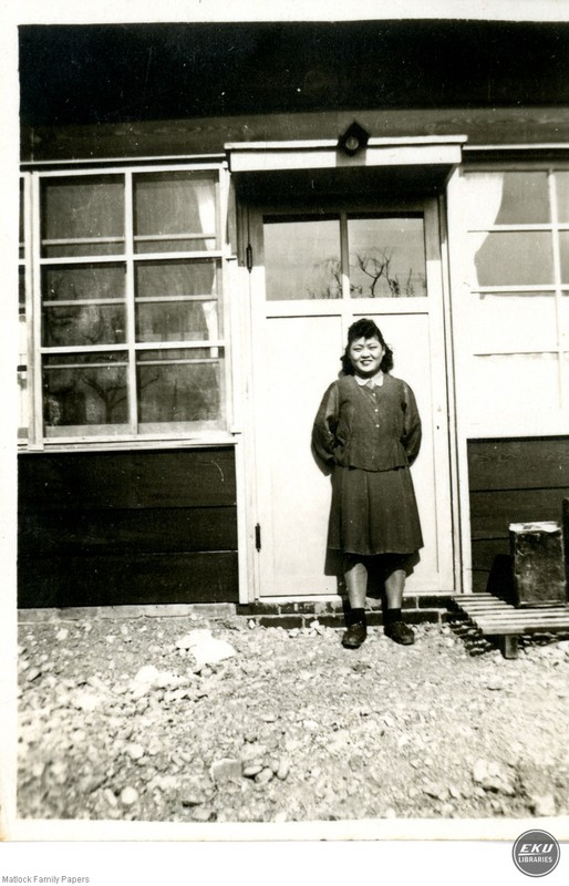 Unidentified Woman Standing in Front of a Building