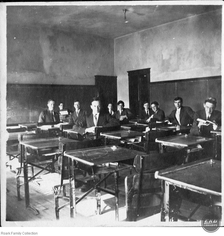 Unidentified Men in a Classroom