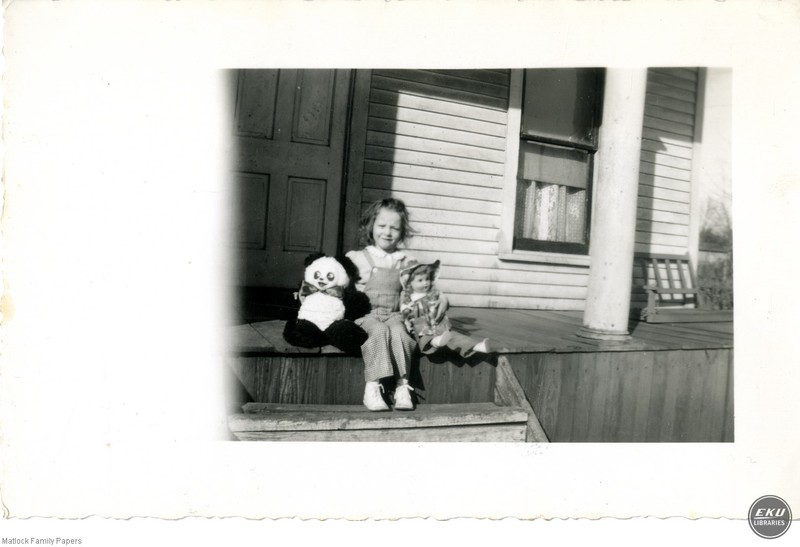 Unidentified Girl Sitting on a Porch