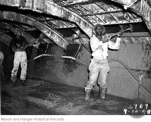 Workers in Concrete Tunnel