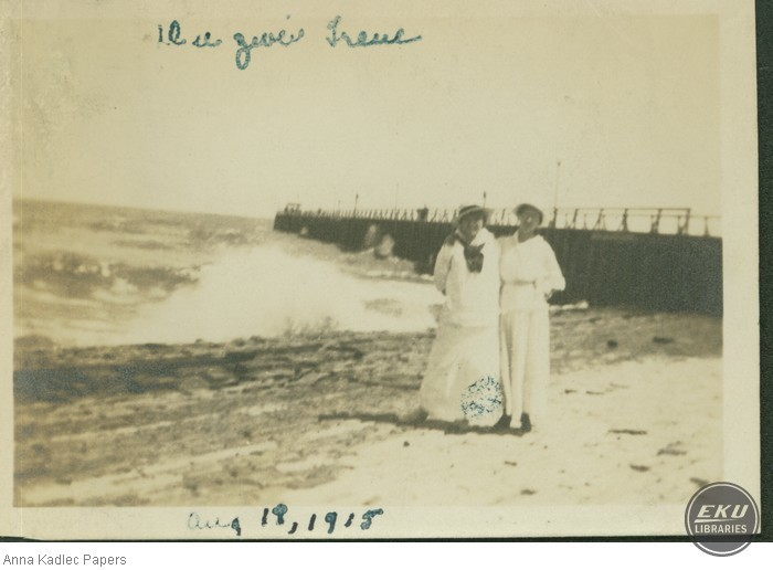 Two Women in Front of a Pier