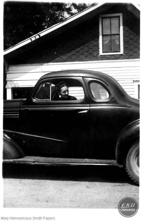 Unidentified woman in a car