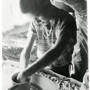 Unidentified Boy Throwing a Pot