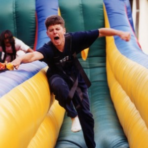 Students on a blowup slide